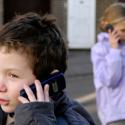 kid using mobile phone